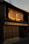 Traditional wooden house with black tiled roof.