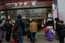 A local mascot greets travellers as they enter Kanazawa Station