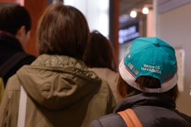A train enthusiast wears her favourite shinkansen cap