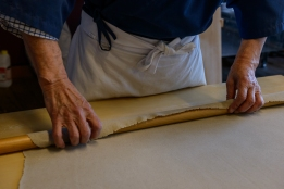 Rolling out the dough to be just 2mm thick.