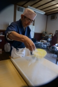 Extra soba flour (buckwheat flour) is added before each rolling session.