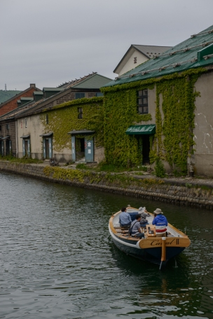 Tourists enjoy a very brief 'cruise' along the famous canal in Otaru, Hokkaido, Japan.