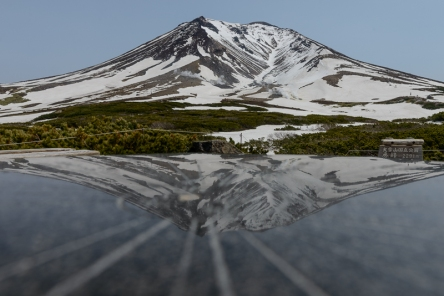 Asahidake, a volcano, relected on a polished stone map in Daisetsuzan National Park.