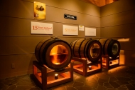 Barrels showing how the whiskey changes colour as it matures, Nikka Distillery, Hokkaido, Japan.