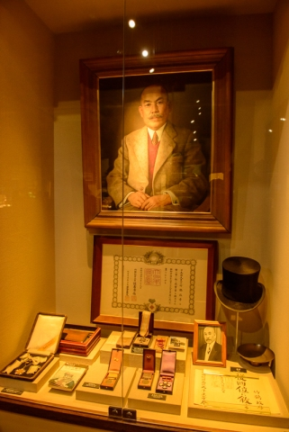 Some of Nikka Whisky founder Masataa Taketsuru's possessions, Whiskey bar inside the Whisky Museum, Nikka Distillery, Hokkaido, Japan.