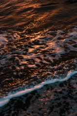 Sunset reflected in the sea foam - Sea of Japan, Ishikawa Prefecture, Japan.